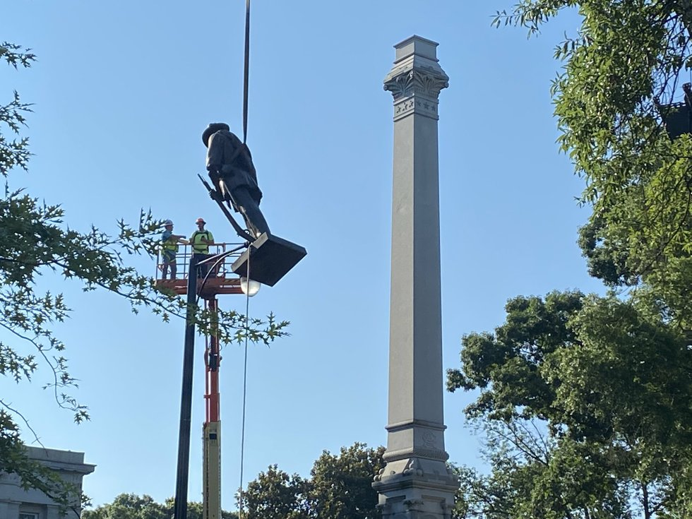 Protesters tear down statues from Confederate monuments in DC and North Carolina