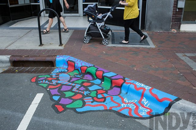 The Drain On Main Is Only For The Rain Durham Hired Artist Candy